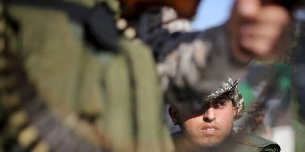 A member of Palestinian security forces loyal to Hamas looks on as he is deployed to maintain security...