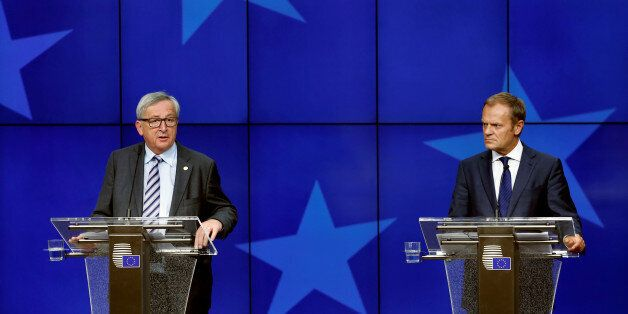 European Commission President Jean-Claude Juncker and European Council President Donald Tusk (R) address...