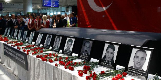In this Thursday, June 30, 2016 photo, family members, colleagues and friends of the victims of Tuesday...