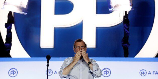 MADRID, SPAIN - JUNE 26: Spanish leader of the People's Party Mariano Rajoy addresses their supporters...
