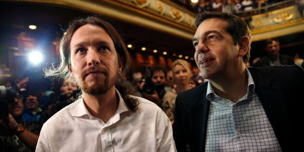 Podemos ('We can') Secretary General Pablo Iglesias (L) and Alexis Tsipras, leader of Greece's Syriza...
