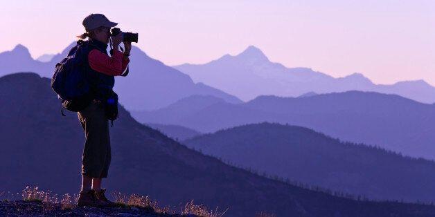 USA, Washington State, Okanogan National Forest, Pasayten Wilderness, Slate Peak, Woman taking picture...