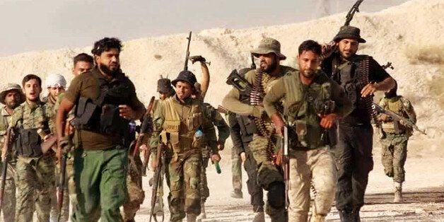 This file photo released Tuesday June 28, 2016 by the New Syrian Army, an anti-government rebel group,...