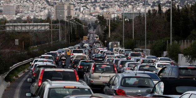 Cars line up on a traffic jam along a road leading to Athens city centre during a strike by urban transport...
