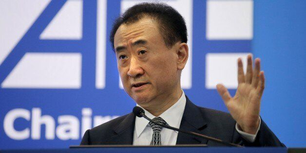 Wang Jianlin, chairman of Wanda Group, delivers a speech at the Ninth Asian Financial Forum in Hong Kong,...