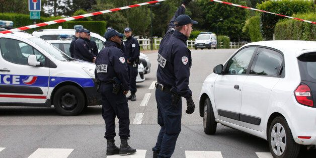 French police officers work at the crime scene the day after a knife-wielding attacker stabbed a senior...