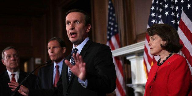 WASHINGTON, DC - JUNE 20: U.S. Sen. Christopher Murphy (D-CT) speaks as Sen. Dianne Feinstein (D-CA)...