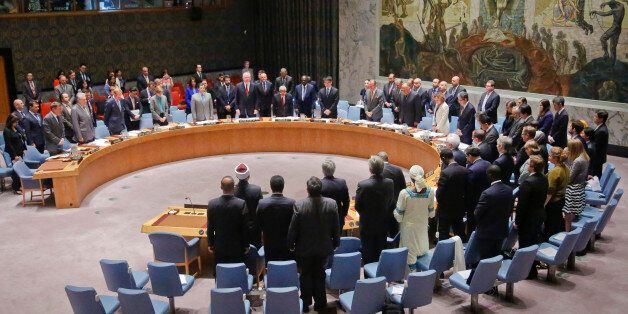 Participants in a Security Council meeting on terrorism, stand in a moment of silence for victims of...
