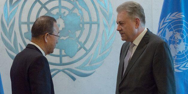 UNITED NATIONS HEADQUARTERS, NEW YORK, NY, UNITED STATES - 2016/01/04: Volodymyr Yelchenko (right) presents...