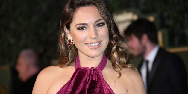 Kelly Brook poses for photographers upon arrival the Evening Standard Theatre Awards in London, Sunday,...