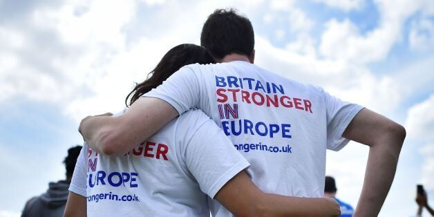 People wear 'Stronger-In' themed t-shirsts as they lsten to speakers at a rally for 'Britain Stronger...