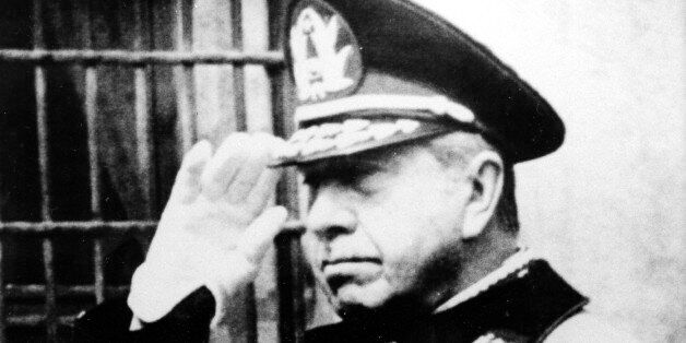 FILE - In this Sept. 18, 1985 file photo, Chile's Gen. Augusto Pinochet salutes during Independence Day...