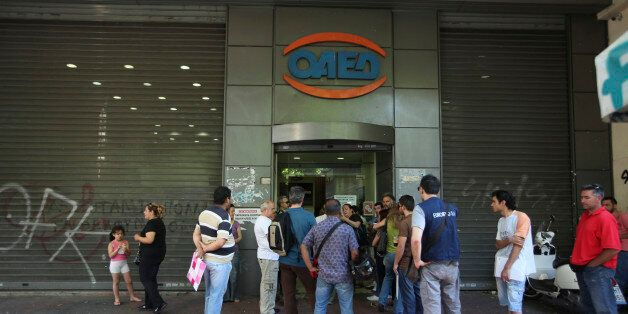Jobseekers wait outside an OAED employment center in Athens, Greece, on Friday, June 15, 2012. Greeks...