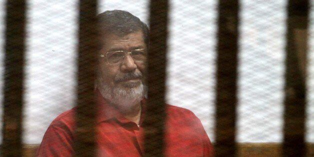 CAIRO, EGYPT - MARCH 7: Egypts ousted President Mohamed Morsi is seen behind the bars during his trial...