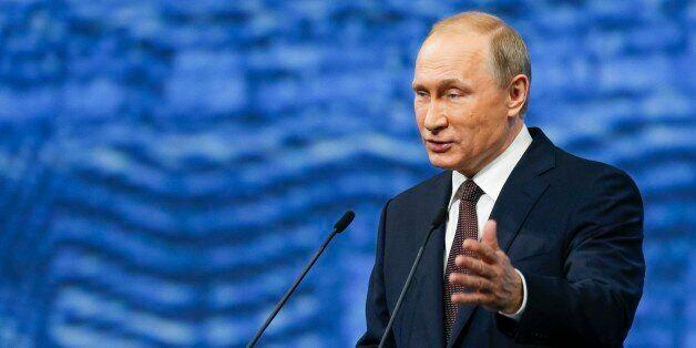 Russian President Vladimir Putin gestures as he addresses the St. Petersburg International Economic Forum...