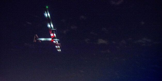 In this photo provided by Solar Impulse 2, the solar powered plane, piloted by Swiss pioneer Bertrand...