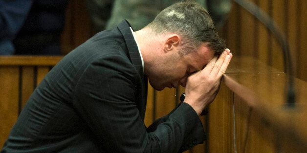 South African Paralympian Oscar Pistorius breaks down at the Pretoria High Court on June 14, 2016 on...