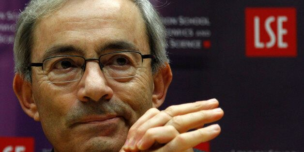 Nobel prize winner Christopher Pissarides gestures during a news conference in London October 11, 2010....