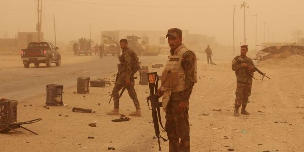 Iraqi government forces are seen on June 16, 2016 after recapturing the town of Zankura, northwest of...