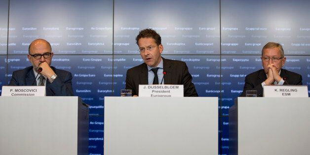 Jeroen Dijsselbloem, center, Dutch finance minister and head of the group of euro-area finance ministers,...