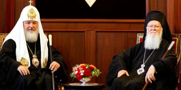 Ecumenical Greek Orthodox Patriarch Bartholomew I (R) and Russian Orthodox Patriarch Kirill pose for...