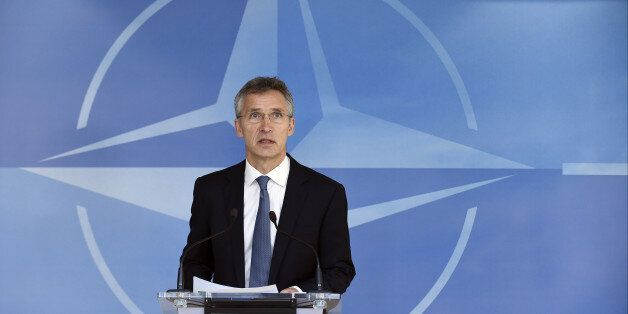 NATO Secretary-General Jens Stoltenberg gives a joint press before a Nato Defense Council meeting at...