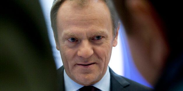 European Council President Donald Tusk speaks with journalists as he arrives at the European Council...