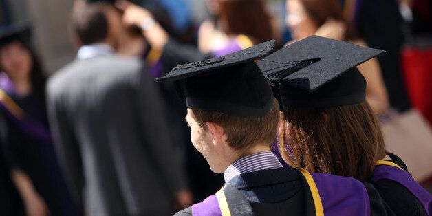 Students from the London School of Economics & Political Science (LSE) wear mortar boards and gowns during...