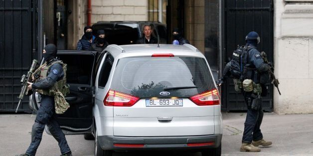 A convoy of French police and members of the National Gendarmerie Intervention Group (GIGN) transporting...