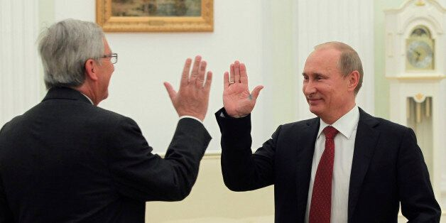 Russian President Vladimir Putin, right, and Luxembourg Prime Minister Jean-Claude Juncker greet each...