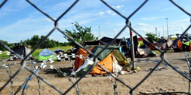 CSONGRAD, HUNGARY - JUNE 9: Refugees try to live under hard conditions in a tent camp as Hungary closes...