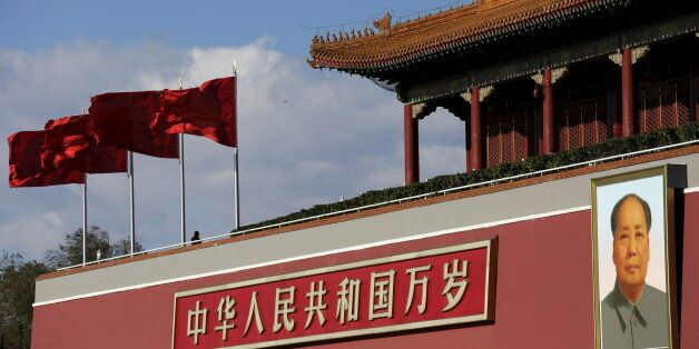 A giant portrait of Chinese late chairman Mao Zedong is seen on the Tiananmen gate on a sunny day December...