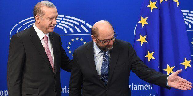 Turkey's President Recep Tayyip Erdogan (L) speaks with European Parliament President Martin Schulz at...