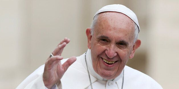 Pope Francis waves as he arrives to lead a weekly audience in Saint Peter's Square at the Vatican June...