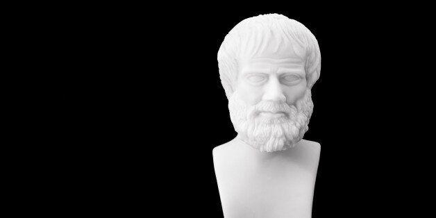 Greek philosopher Aristotle (384-322 B.C.E.) sculpture isolated on black