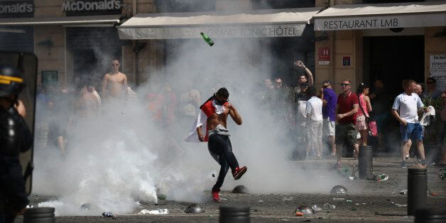 MARSEILLE, FRANCE - JUNE 11: England fans react after police sprayed tear gas during clashes ahead of...