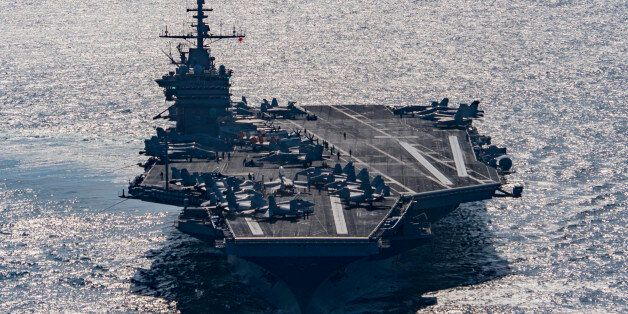 In this Friday, Dec. 25, 2015 photo released by the U.S. Navy, the aircraft carrier USS Harry S. Truman...