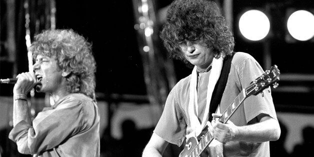 ** FILE ** Singer Robert Plant, left, and guitarist Jimmy Page, right, of the British rock band Led Zeppelin...