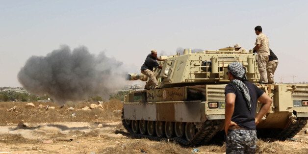 Forces loyal to Libya's UN-backed unity government fire from a tank in Sirte's centre towards Ouagadougou...