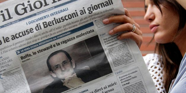 Two women read the Il Giornale with a picture Dino Boffo, editor of Avvenire -- the Italian Bishops Conference's...