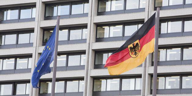 The European Union (EU) flag, left, flies beside Germany's national flag outside the Deutsche Bundesbank...