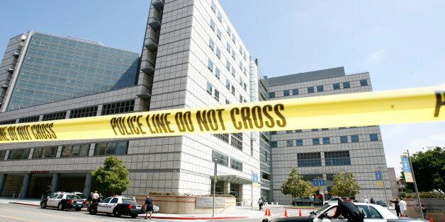 Police tape hangs across the street near the emergency room dock at UCLA Medical Center in Los Angeles...