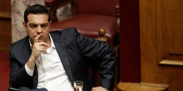 Greek Prime Minister Alexis Tsipras attends a parliamentary session, before a vote on a new package of...