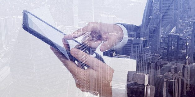 Double exposure of businessman and cityscape. Business & technology