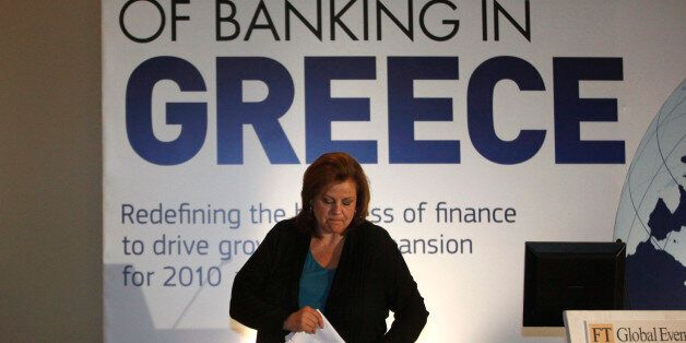 Louka Katseli, Greece's economy minister, leaves the podium after speaking at the 'Future of Banking'...