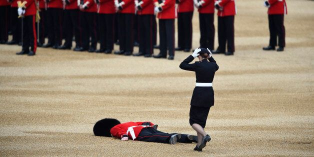 A Guardsman faints at Horseguards Parade for the annual Trooping the Colour ceremony in central London,...