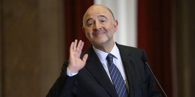 The European Comissioner for Economic and Finacial Affairs Pierre Moscovici gestures during a news conference,...