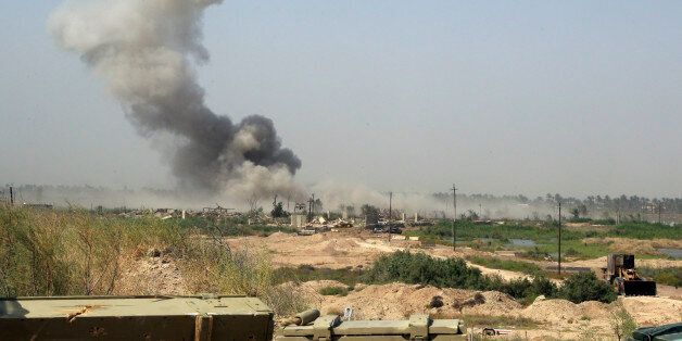 Smoke rises from Islamic State group positions after an airstrike by U.S.-led coalition warplanes as...