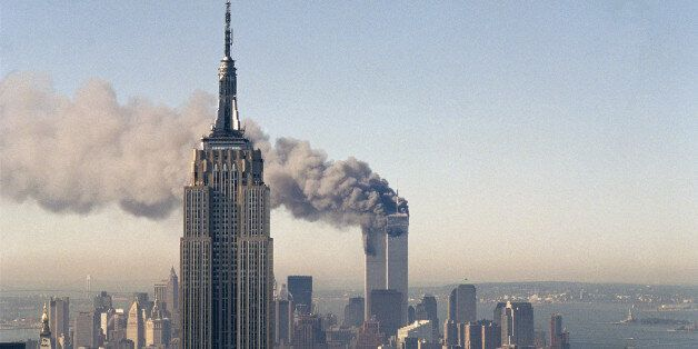 FILE - In this Sept. 11, 2001, file photo, the twin towers of the World Trade Center burn behind the...