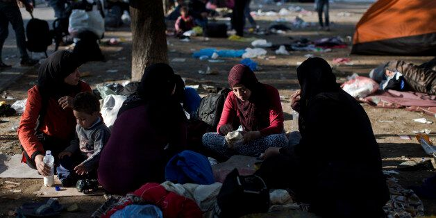 Migrants rest at a park in Belgrade, Serbia, Thursday, Aug. 27, 2015. Over 10,000 migrants, including...